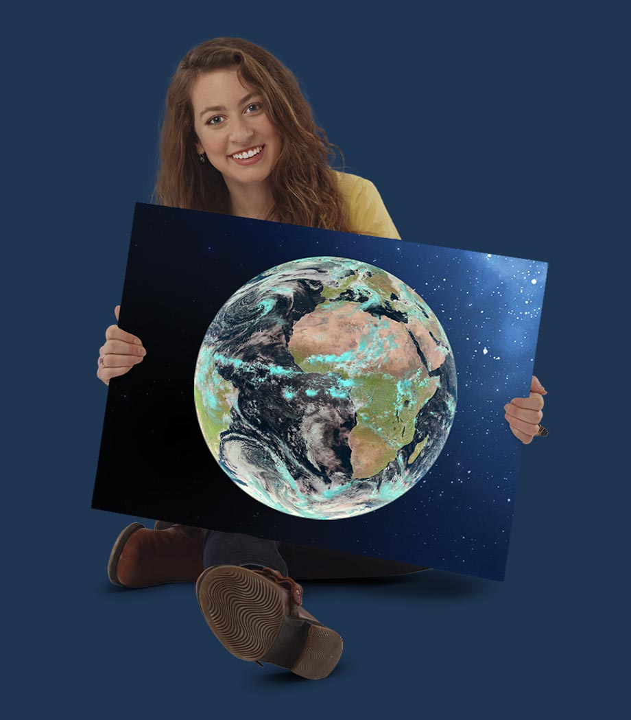 Girl holding a satellite image of Earth